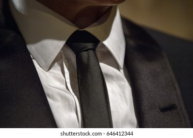 black tie on white shirt detail close up