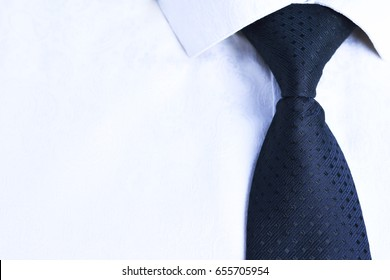 Black tie in polka dots on a white elegant elegant shirt. Business