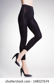 black tights on sexy woman legs isolated on grey