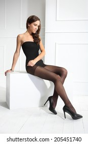 Black tights .Thin tights .Beautiful, leggy woman in thin tights and fashionable styling
