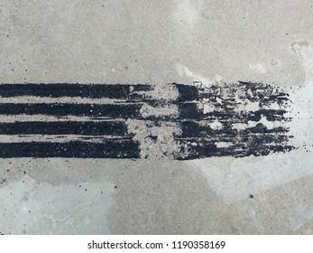 black tire track on dirty concrete after sudden brake
