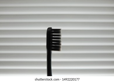 Black toothbrush made of charcoal to protect tooth and clean mouth effectively by using with high quality toothpaste. Dentist suggest to use charcoal toothbrush to reduce  decayed tooth, teeth stain