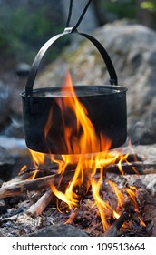 black tourist kettle on fire close up