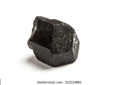 Black tourmaline crystal isolated on a white background