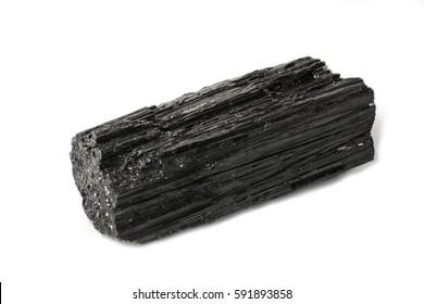 Black tourmaline stone placed on the white background. Horizontal studio shot.