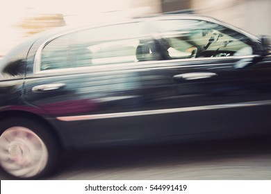 Black Town Car in Motion