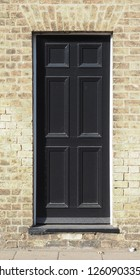 black traditional entrance door of a British house