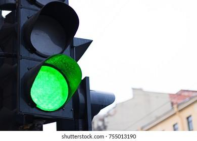 Black traffic light. Green light. Close-up.