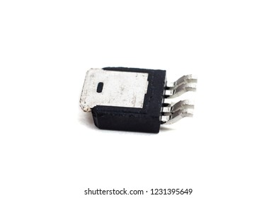 Black transistor on a white background close up, macro photo