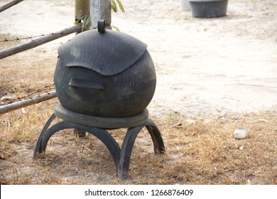 Black trashcan made from Whell