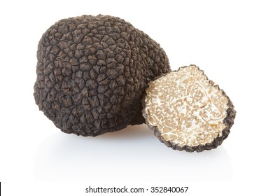 Black truffle and half isolated on white, clipping path included