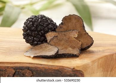black truffle mushrooms on chopping board