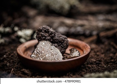 Black truffles slices in wooden plate