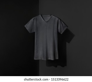 Black t-shirt for man on shadowed background