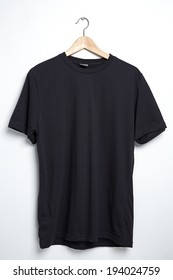 Black tshirt template on hanger ready for your own graphics.