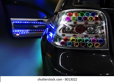black tuning car with a lot of Light Bulb