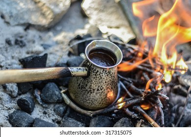 black turkish coffee cooking on the fire