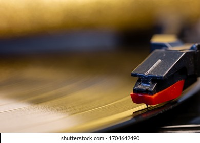 Black turntable. Music from a vinyl record. Zoom in on a turntable. Old music equipment. The best quality of music. Nostalgic devices. Gramophone needle. Music player. Goods from the antique shop.