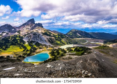 Black tusk mountain with turquoise blue lake and valley scene