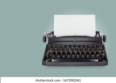 Black typewriter on blue background with copy space for your text