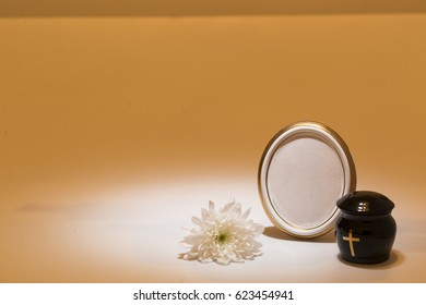 black urn with white tape,white chrysanthemum for sympathy card on yellow background