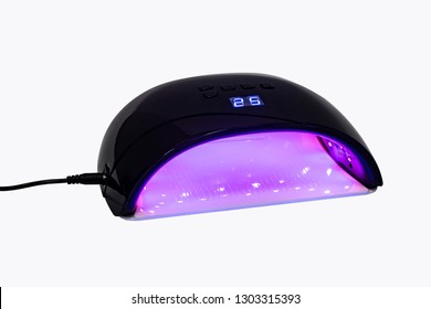 Black UV lamp for manicure on white background