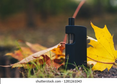 Black Vaping Box Mod In Autumn with Leaves
