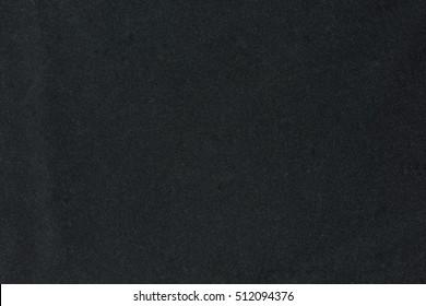 Black velvet fabric backdrop texture background. empty black backdrop for graphic design.