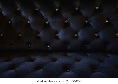 Black velvet fabric sofa , close up modern sofa for background or texture