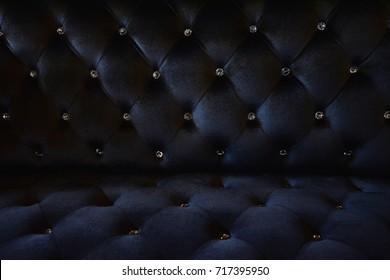 Black velvet fabric sofa , close up modern sofa for background or texture