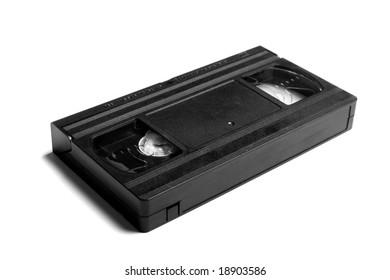 Black video cassette on white background. Shallow DOF.