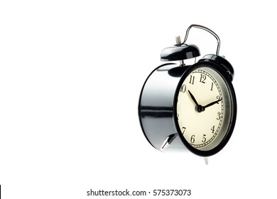 black vintage alarm clock isolated floating on white background show time at ten minutes past ten o'clock
