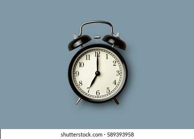 black vintage alarm clock on gray color background