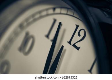 Black, vintage alarm clock with qwhite background