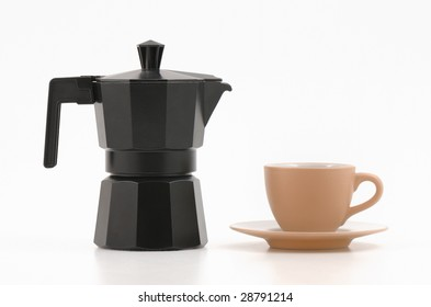 Black vintage coffee machine and cup of coffee on white background