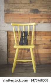 Black vintage corset suede boots on a yellow chair creative wedding shoes photo steam punk style witch boots