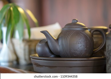 Black vintage teapot and cup