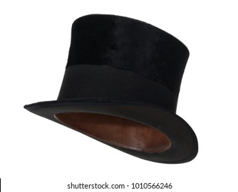 Black vintage top hat, isolated on white background.  Almost straight side view. Tilted up a little, showing the interior leather band.