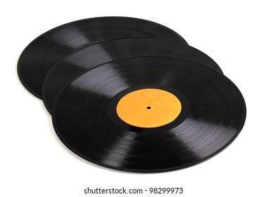 Black vinyl records isolated on white