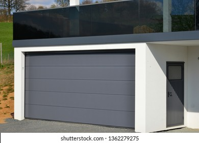 Black vitrified High-grade Steel Balcony and modern Car Garage with automatic Door