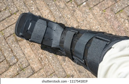 Black walker as an orthopedic device after a single operation. The walker can be made suitable with velcro touch fasteners.