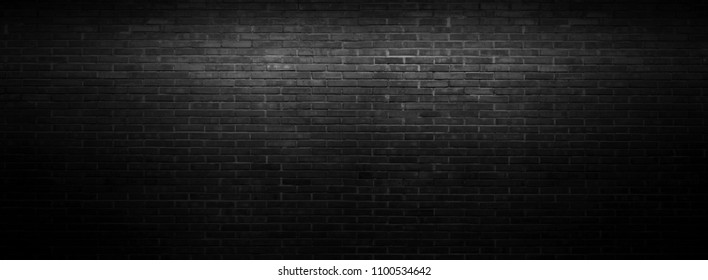 Black wall background The surface of the brick dark jagged. Abstract black wall background