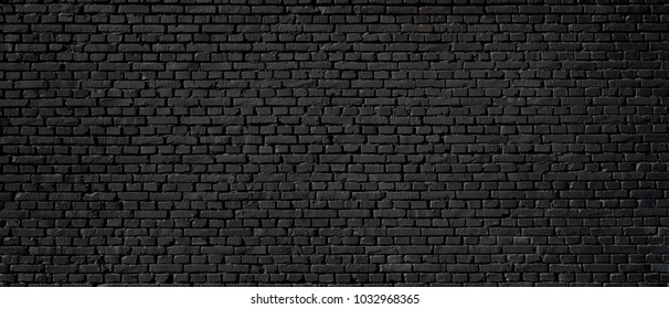 Black wall as background, texture of a black brick wall