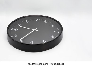 Black Wall clock with white numbers closeup. Include path for selection, dicut work.