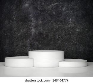 black wall and empty podium