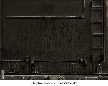 black wall with iron stairs