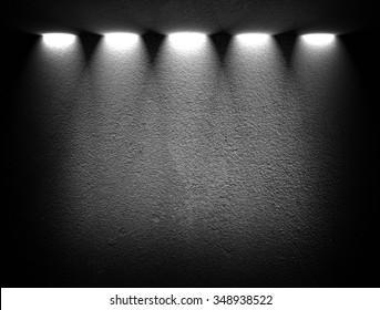 black wall with spotlights