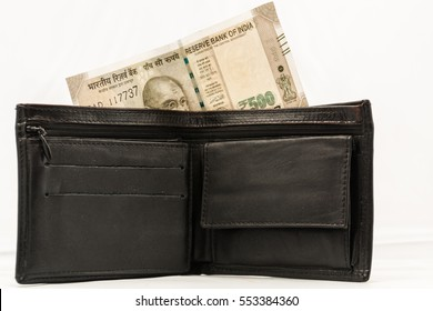 Black wallet with Five hundred rupee Indian currency