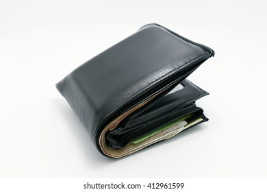 black wallet full of money soft focus