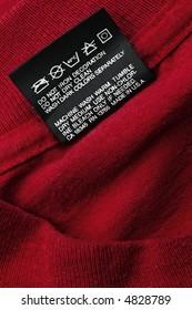 black washing instruction tag on red t-shirt